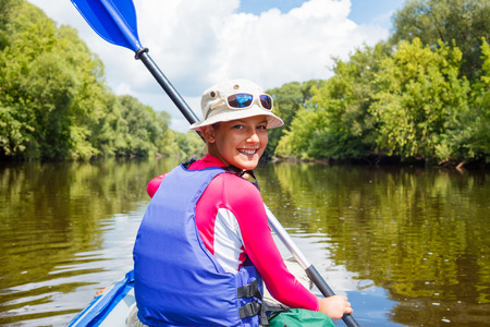 canoeing: Girl kayaking Stock Photo