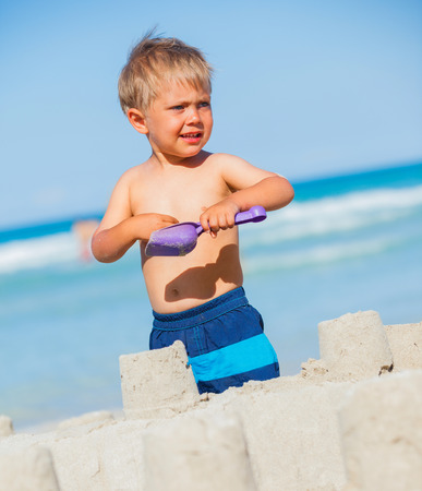 2 3 years: Boy playing on the beach