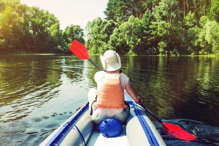 Woman kayaking on river