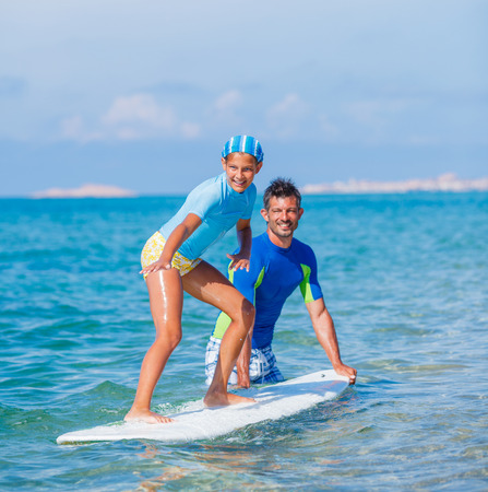 Girl with surf photo