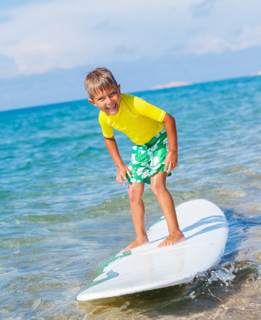 male surfer: Boy with surf Stock Photo