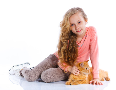 sit studio: Girl with her cat Stock Photo
