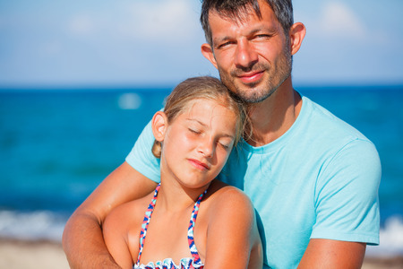 Father and his daughter at beach Stock Photo