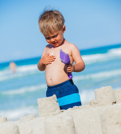 children sandcastle: Boy plaing on the beach Stock Photo