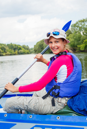 Girl kayaking Stock Photo