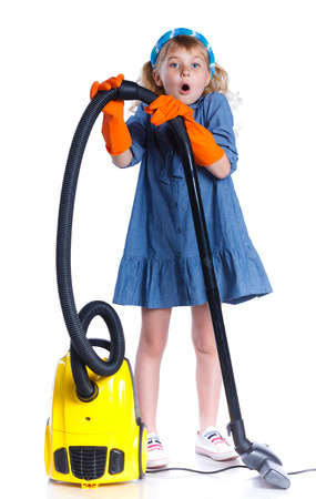 5 6 years: Little cleaning girl. Stock Photo