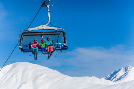 snow ski: Ski, skiing - family skiers on ski lift Stock Photo