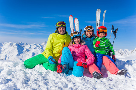 Winter fun, skiing - happy family ski team Stock Photo