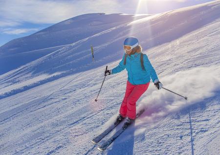 ski jump: Woman On the Ski in winter resort Stock Photo