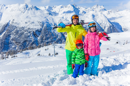 winter people: Skiing, winter fun - happy family on ski holiday