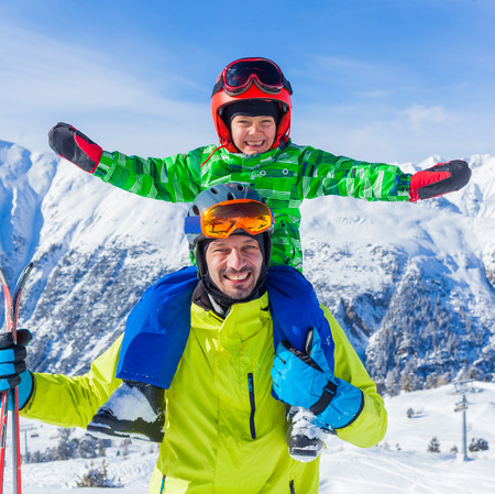 skiing: Skiing, winter fun - happy little boy with his father on ski holiday