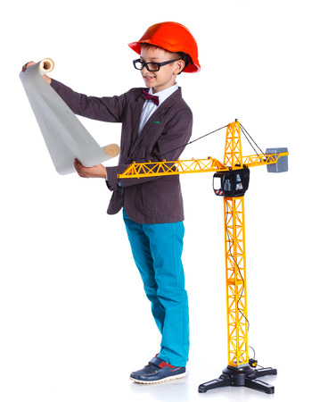 executive helmet: Young Architect in hardhat, holding blueprints. Isolated on white background
