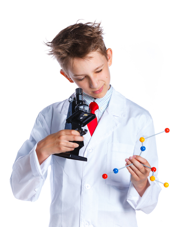 microscope isolated: Happy enthusiastic Chemist boy with microscope. Isolated on a white background