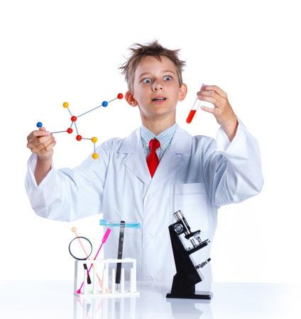 microscope isolated: Happy enthusiastic Chemist boy with chemical test tubes and microscope. Isolated on a white background Stock Photo