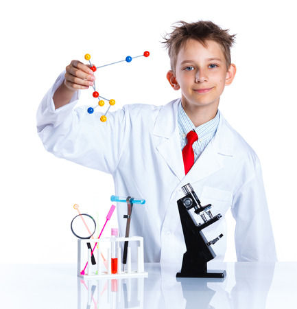 youth background: Happy enthusiastic Chemist boy with chemical test tubes and microscope. Isolated on a white background Stock Photo