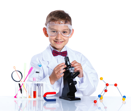 microscope isolated: Happy enthusiastic Chemist little boy with flasks for chemistry and microscope. Isolated on a white background
