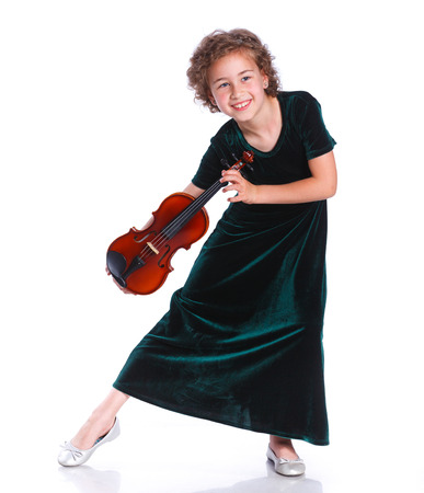 beautiful preteen girl: Happy preteen girl playing violin against white background