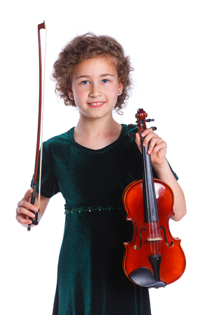 pretty teenage girl: Portrait of happy preteen girl playing violin against white background