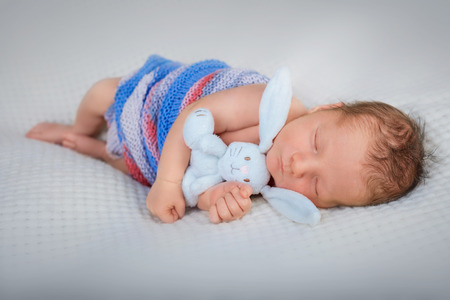 soft toy: Newborn baby boy 10 day old sleeping with soft toy