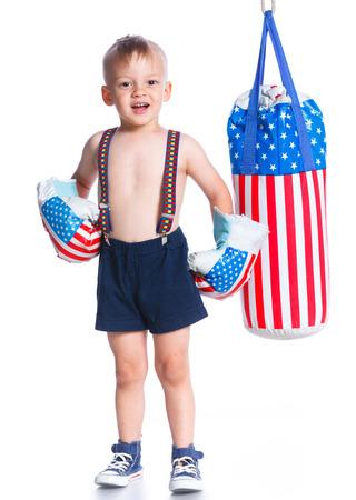 symbol sport: Cute little boxer boy wearing a boxer gloves