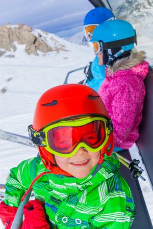 kids at the ski lift: Ski, skiing - Portrait of little skier boy on ski lift