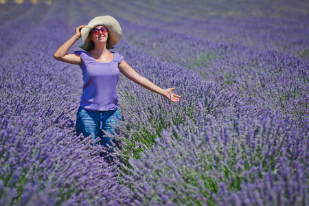 lavander: Beautiful woman admiring the lavander fields in Valensole. Provence, France. Stock Photo