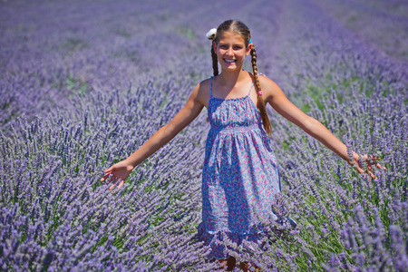 lavander: Beautiful young girl admiring the lavander fields in Valensole. Provence, France.