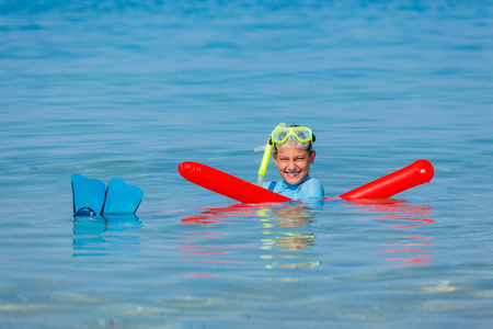 flippers: Joyful girl in mask and with flippers scuba diving.