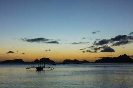 palawan: Sunset with boat  in the Palawan Island in the Philippines. Stock Photo