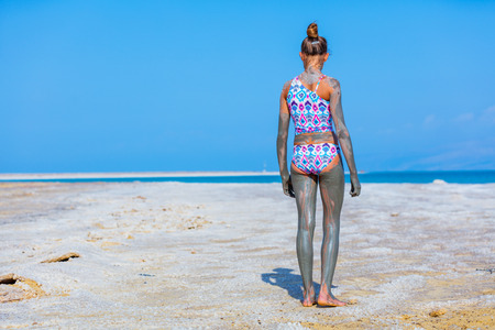 mud girl: Back view of beautiful girl taking Mud SPA At The Dead Sea, Israel.