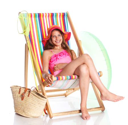 Cute girl in swimsuit and hat with bag. Isolated on white background Stock Photo