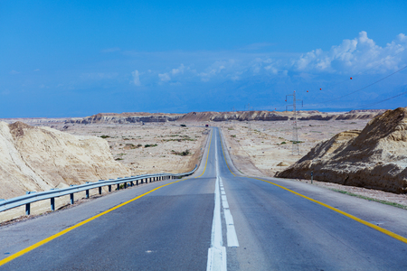negev: Desert road through sandstone, Negev Desert, Israel Stock Photo