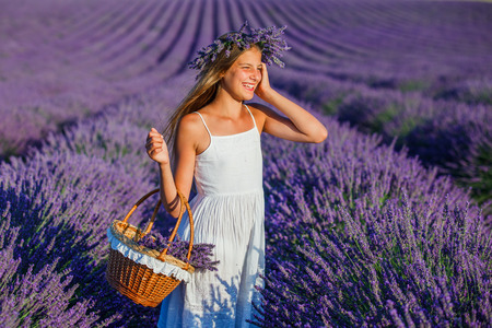 fragrant: Beautiful young girl with basket in the lavander fields in Valensole. Provence, France.