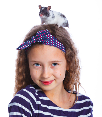 porpoise: Cute girl holding a hamster. Isolated on white background.