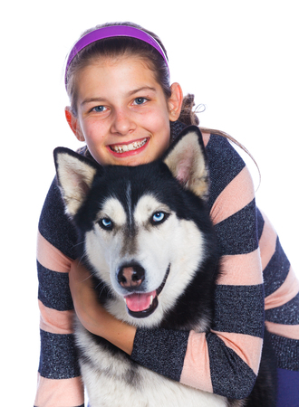 affectionate actions: Cute girl is with her dog husky isolated on white background