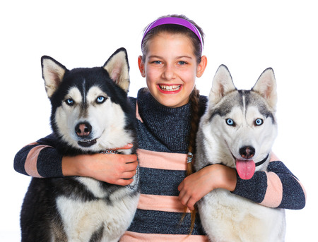 huskies: Cute girl is with her two huskies isolated on white background