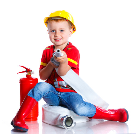 emulate: Expressive cute toddler boy with firemans outfit on. Isolated on the white background