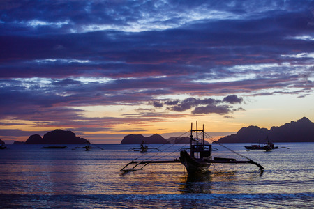 Sunset with boat in the Palawan Island in the Philippines.