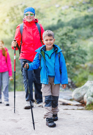 walking paths: Hiking boy in the mountains Stock Photo