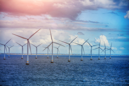Shot of row of floating wind turbines