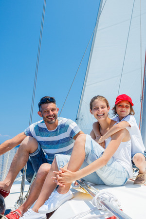 Father with adorable kids resting on yacht