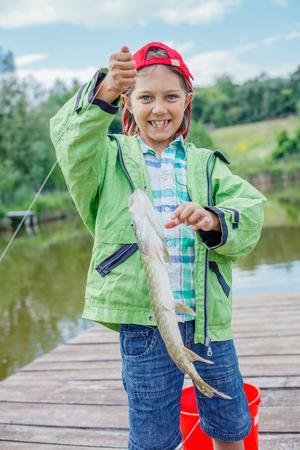 Cute boy enjoyed the fishing