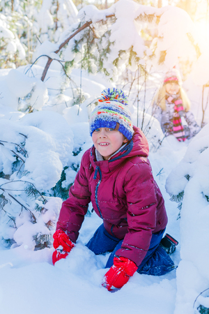 snowdrifts: Boy playing in big snow in winter. Stock Photo