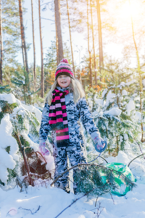 snowdrifts: Girl playing in big snow in winter.