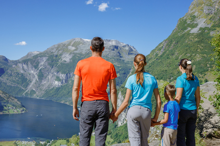 Family with children above Geiranger Fjord. Stock Photo
