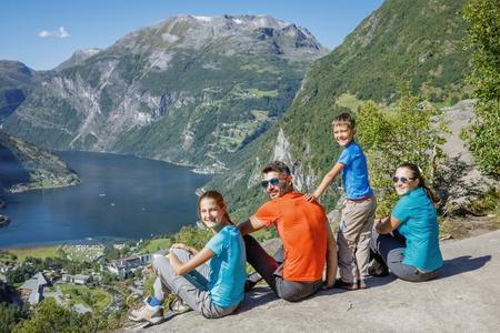 Family with children above Geiranger Fjord. 免版税图像