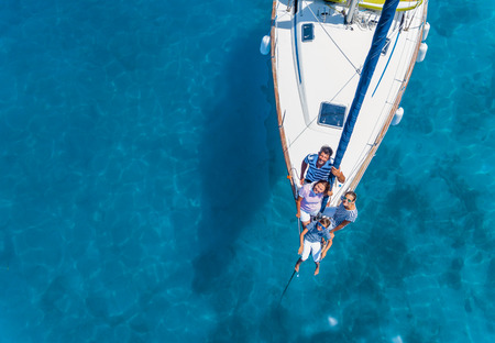 Aerial view of Family with adorable kids resting on yacht