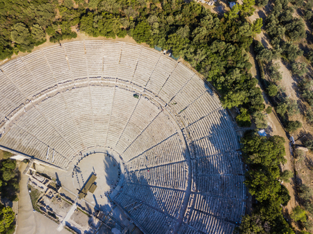 Ancient amphitheater of Epidaurus at Peloponnese, Greece. Aerial drone photo.