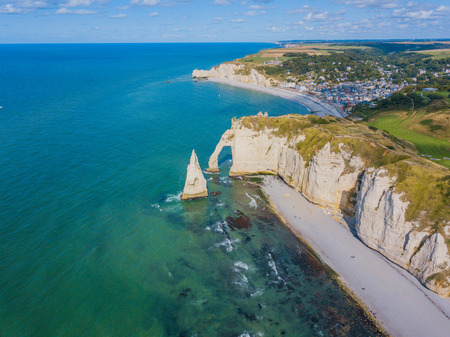 Aerial drone photo of the pointed formation called LAiguille or the Needle and Porte dAval at Etretat, north western France