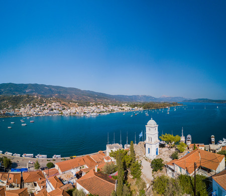 The clock tower of Poros island, Greece. Aerial drone photo